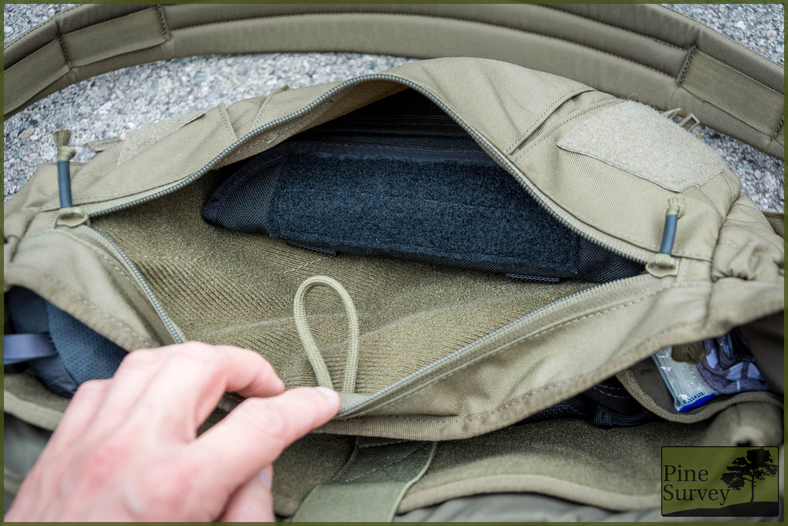 63d0de84a86a The inside of the bellow pocket. Note the velcro-like fabric and paracord  loop.